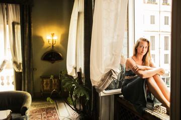 Charming girl in an elegant room