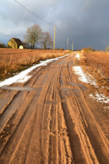 Early spring  gravel road in village