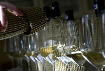 WINE GROWER GUNTHER KUENSTLER PREPARES WINE FOR TASTING IN HOCHHEIM.
