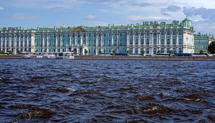Panorama of the Hermitage in St. Petersburg with waves on the Neva River