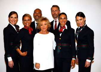 Italian designer Alberta Ferretti poses with Alitalia airline crew during the official presentation of Alitalia's new Alberta Ferretti-designed uniforms in Milan