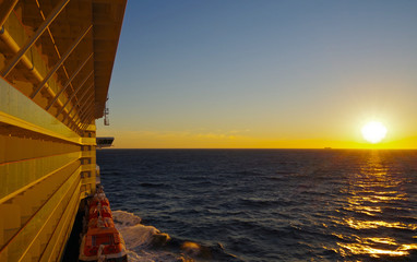 Cruise ship during sunset over Ocean