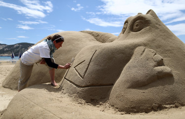 "Artist works on a Sand Sculpture Festival dedicated to the movie ""Madagaskar"" at Rajska (Paradise) beach in Lopar"