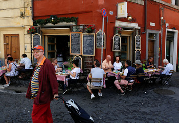 People sit at a restaurant in downtown Rome