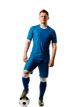 Young handsome football player with a soccer ball posing isolated on white background.