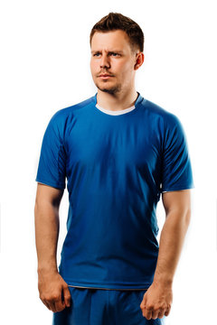 Young handsome football player soccer posing on white isolated background. Blue outfit.