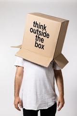 Man with box on his head, think outside the box
