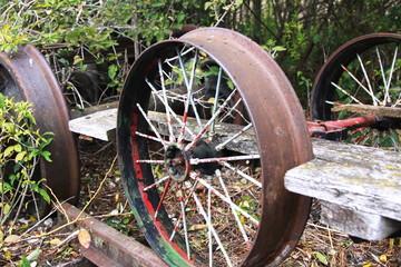 rusty parts of a damaged vintage railroad gang car