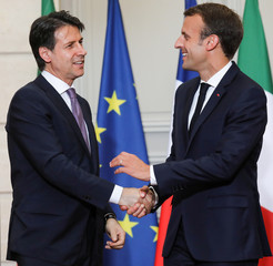 French President Emmanuel Macron and Italian Prime Minister Giuseppe Conte shake hands at the end of a joint news conference at the Elysee Palace in Paris