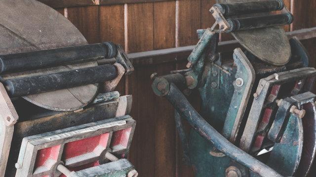 Close up of set old antique letterpress printing black ink machine. Vintage letterpress manual machine.