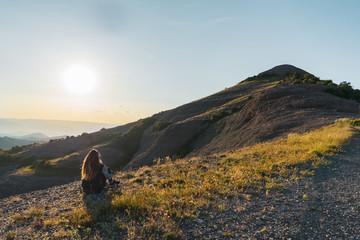 Woman sitting at scenic El Montcau mountain