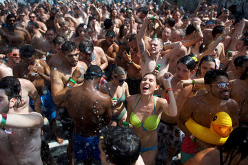 Revellers react while setting the Guinness World Record for the most people taking a simultaneous shower during the second day of the Firefly Music Festival in Dover, Delaware