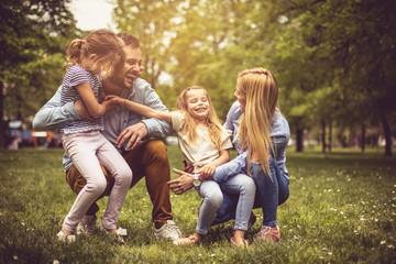 Family at park. Fotoväggar
