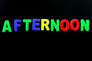 English letters in black background are the words afternoon.