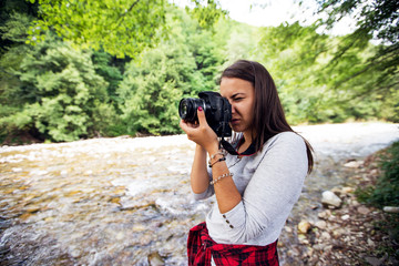 Young female photographer outdoor