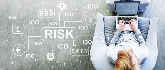 Cryptocurrency ICO Risk Theme with man using a laptop in a modern gray chair