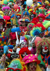CLOWNS PACK THE ROAD DURING THE CARNIVAL PARADE IN SESIMBRA VILLAGE 30 KM SOUTH OF LISBON.