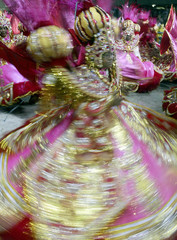 BRAZILIAN CARNIVAL DANCERS PERFORM DURING THE SAMBA SCHOOL PARADE IN RIO DE JANEIRO.