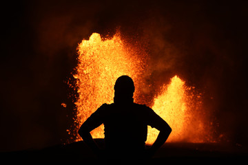Selfie in front of a lava fountain of the volcanic eruption of Kilauea in Hawaii