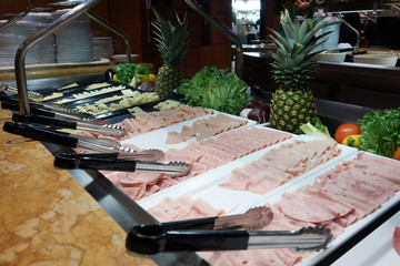 Buffet on the cruise ship. Sliced sausage, ham and cheese
