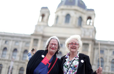 Susanne Scholl and Monika Salzer, founders of grannies against right, pose during a rally in Vienna