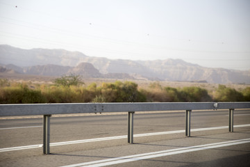 Journey on the highway through the Judean desert surrounded by mountains