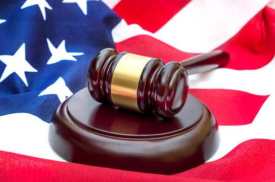 Judge's gavel on american flag. American law.