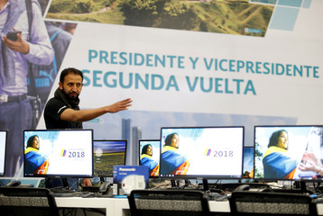 A worker finish up the final details in a centre to be used for the second round of the presidential election in Bogota
