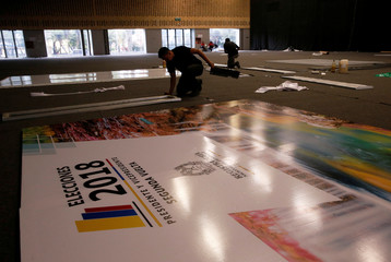 Workers finish up the final details in a centre to be used for the second round of the presidential election in Bogota