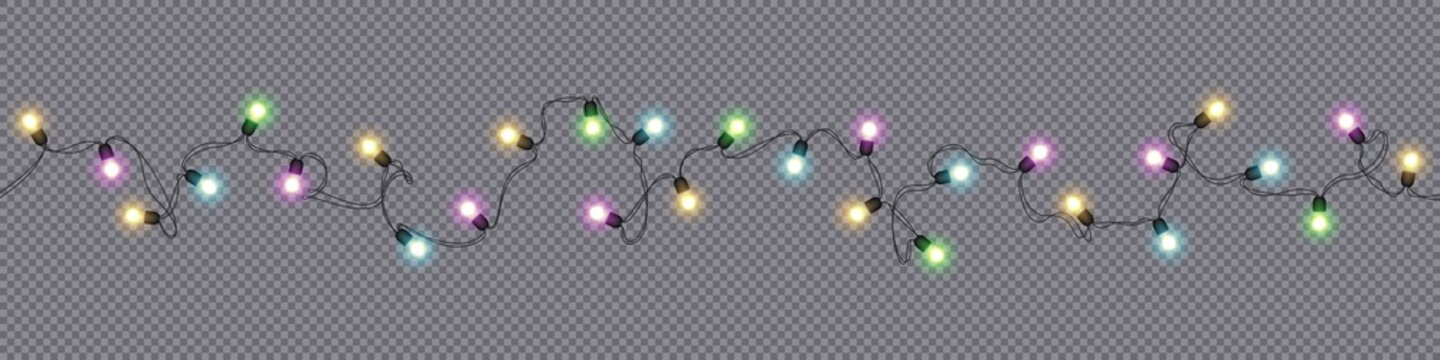 Christmas and New Year garlands with glowing light bulbs
