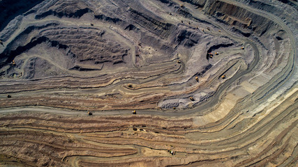 Aluminium Prints Aerial view of opencast mining quarry with lots of machinery at work.