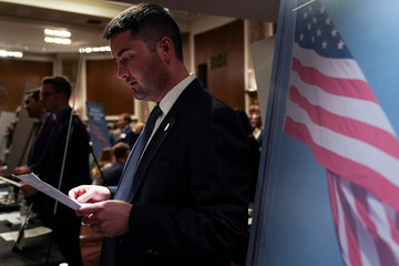 A representative of the Department of Homeland Security reads a resume during the Executive Branch Job Fair hosted by the Conservative Partnership Institute at the Dirksen Senate Office Building in Washington