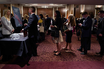People wait in line at a stand during the Executive Branch Job Fair hosted by the Conservative Partnership Institute at the Dirksen Senate Office Building in Washington
