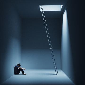 Ein Mann sitzt depressiv in einem Raum mit Leiter
