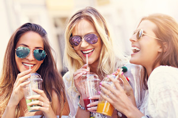 Fototapeta Happy girl friends hanging out in the city in summer obraz