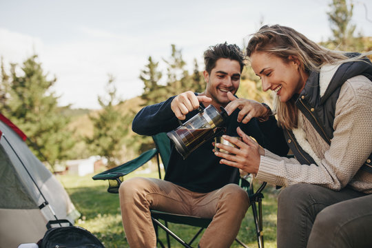 Couple at their campsite having coffee