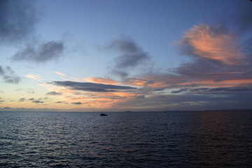 Sun rising on the sea