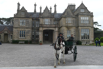 Security check the outside of Muckross House as a jaunting car prepares for the arrival of Prince Charles in the County Kerry town of Killarney