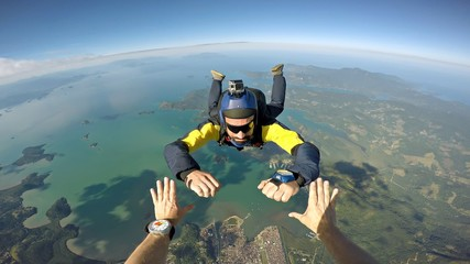 Skydiver point of view above the beach