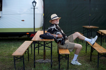 John MacDonald, 72, sits in the VIP ticketed area on the second day of the Firefly Music Festival in Dover, Delaware U.S.