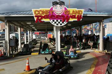 Muslim girls race go-karts on Eid Al-Fitr at Luna Park in Coney Island, Brooklyn, New York