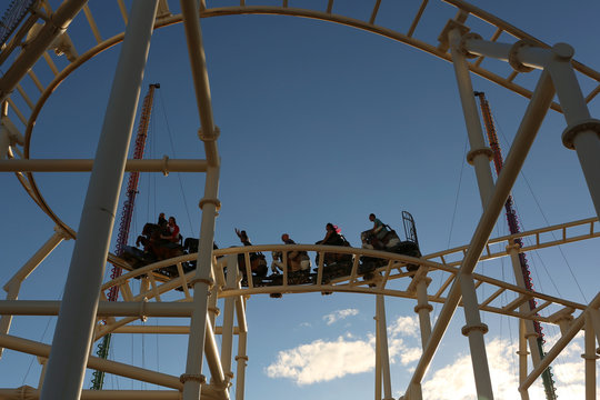 People sit on a rollercoaster at Luna Park in Coney Island, Brooklyn, New York