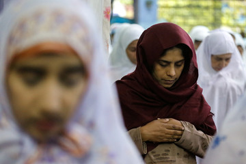 Myanmar Muslims take part in morning prayers during the first day celebration of Eid al Fitr at a mosque in Yangon
