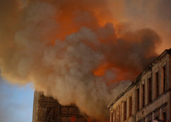 Firefighters attend to a blaze at the Mackintosh Building at the Glasgow School of Art, which is the second time in four years, Glasgow, Scotland, Britain