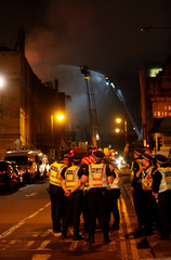 Police and firefighters attend to a blaze at the Mackintosh Building at the Glasgow School of Art, which is the second time in four years, Glasgow, Scotland, Britain