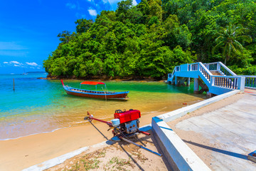 a small beach at Ao Yon. There are actually two Ao Yons lying south of Cape Panwa and they are separated by a rocky headland. Ao Yon junior is home to a large shrimp farm