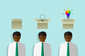 Thinking out of the box concept with black businessman having a cardboard box above his head and colorful lightbulb as creative idea symbol