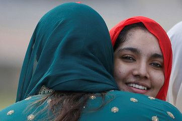Sri Lankan Muslims embrace each other after morning prayers for Eid al-Fitr celebrations, to mark the end of the holy fasting month of Ramadan, in Colombo