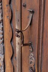 church brown wooden door with handles details