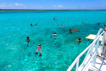 Cozumel, Mexico - Group of friends relaxing together on a party boat tour of the Carribean Sea